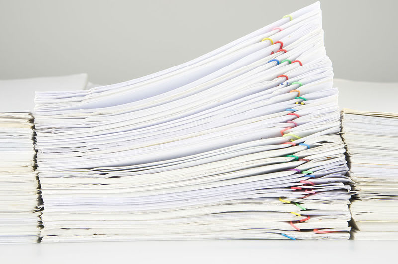 Close-up of stacked files on desk in office