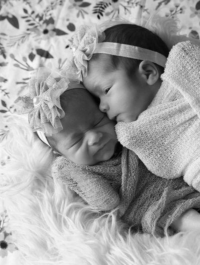 Newborn twin girls, black and white