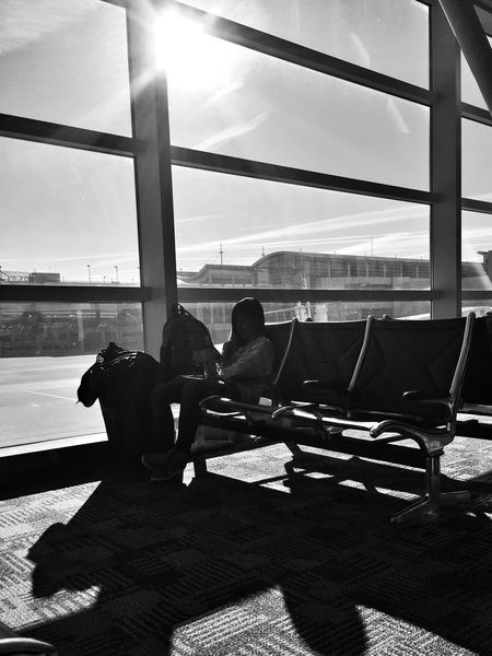 Layover Sitting Sunlight Window Full Length Sky Day Shadow Lifestyles Airport Departure Area Young Adult Airport Layovers Blackandwhite Contrast Woman Black And White Friday