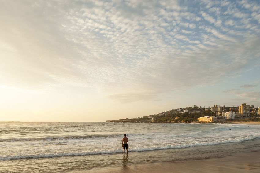 Adult Adults Only Beach Beach Fishing Cloud - Sky Coogee Day Fishing Full Length Human Body Part Isolation Morning Light One Man Only One Person Outdoors People Score Sea Sky Solace Solo Sunrise Sunset Sydney Travel Destinations Adapted To The City
