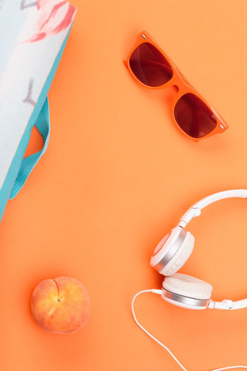 Sunglasses, glass with drink, headphones, peach, blanket on orange background. Minimal summer style Orange Color Blanket Food Drink Fruit Headphones Listening To Music Music Listening Sunglasses Freshness Fresh Lifestyles Minimal Nobody Style Outdooors Peach Bright Summer Summertime Minimalism Flat Lay Overcast