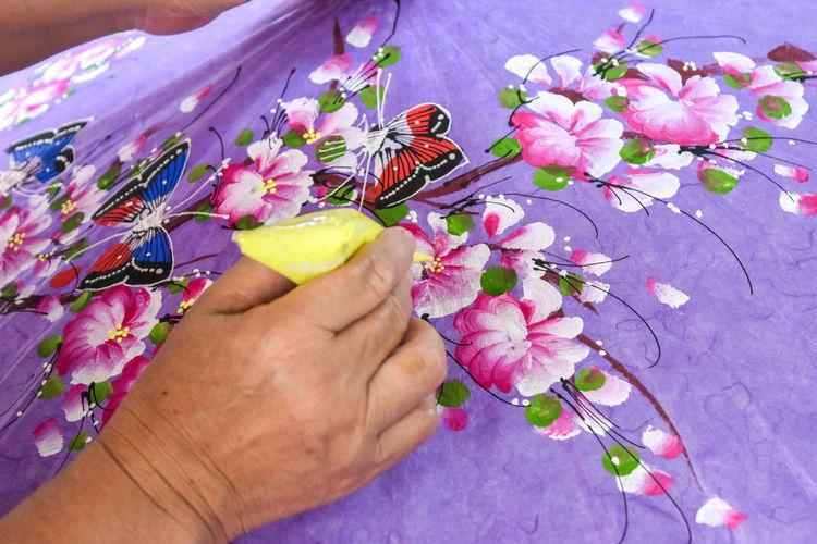 Craftsperson Making Paper Umbrella At Workshop