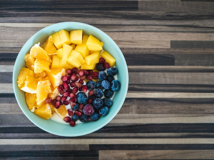 Healthy eating: Delicious bowl with blueberries, Mango und Pomegranate Food Food And Drink Healthy Eating Fruit Freshness Wellbeing Bowl Berry Fruit Breakfast Ready-to-eat No People Snack Fruit Salad Mango Blueberry Pomegranate Superfood Breakfast