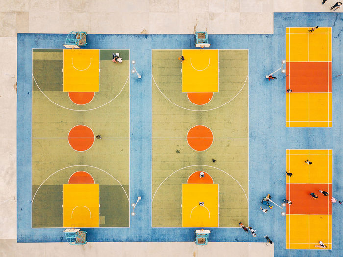 Aerial view of people at basketball courts