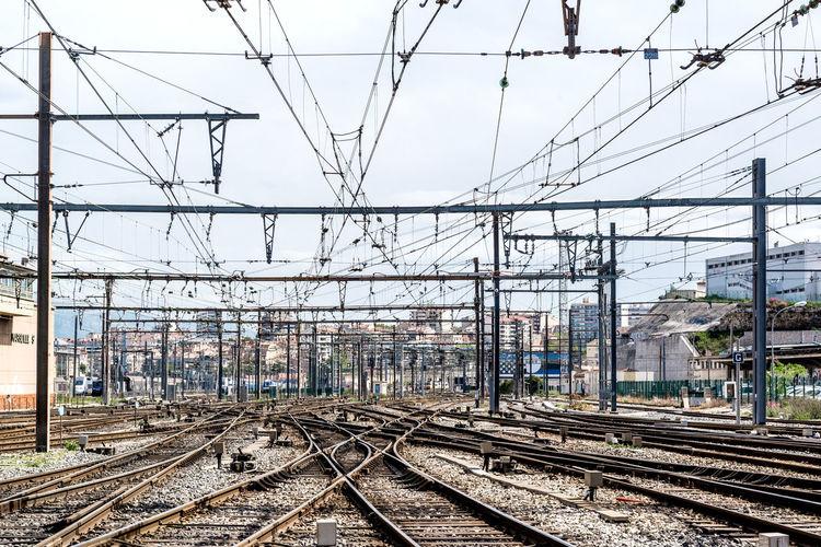 Railroad junctions against sky at gare de marseille-saint-charles