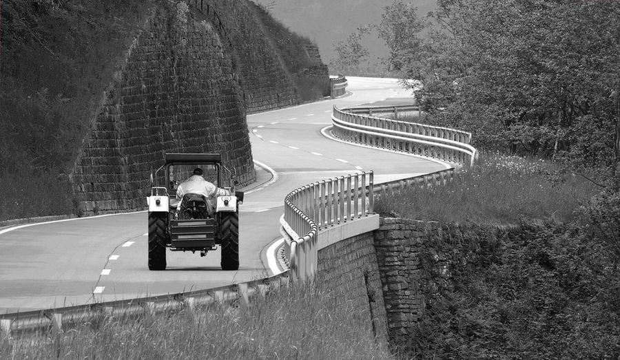 Riding Tractor On Mountain Road