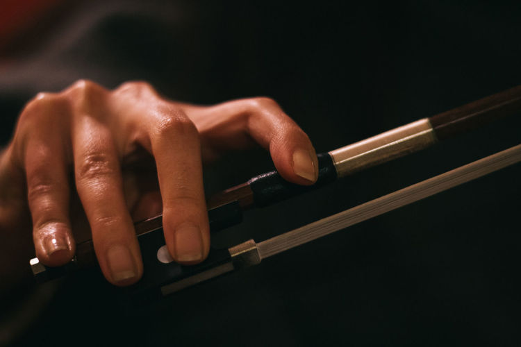 Cropped image of hand holding bow