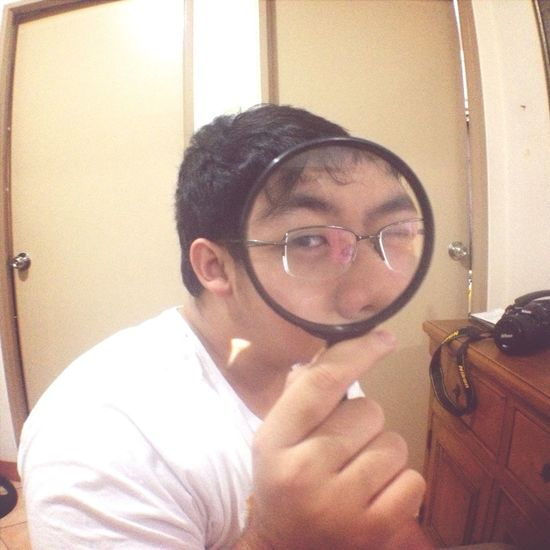Playing with Justin's magnifying glass lol