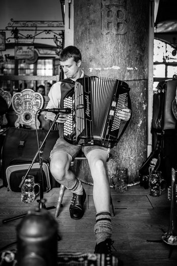 Real People Men One Person Full Length Holding Males  Adult Musical Instrument Casual Clothing Mature Adult Accordion Musician Artist Music Sitting Mature Men Playing Leisure Activity Street Musician