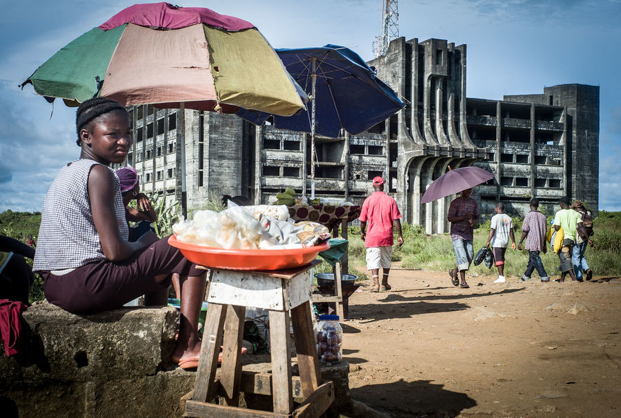 A typical afternoon infront of the ruin of the Ministry of Defense in Monrovia, small businesses everywhere while the reconstruction of he town takes ages, after a long and bloody civil war in Liberia. Midday Sunlight Small Business Small Business Heroes The Photojournalist - 2018 EyeEm Awardk Midday Sunlight Small Business The Photojournalist - 2018 EyeEm Awards The Street Photographer - 2018 EyeEm Awards Africa Day To Day Defence Ministry Monrovia Documentary Heat - Temperature Leica Liberia Monrovia Reportage Sun Protection