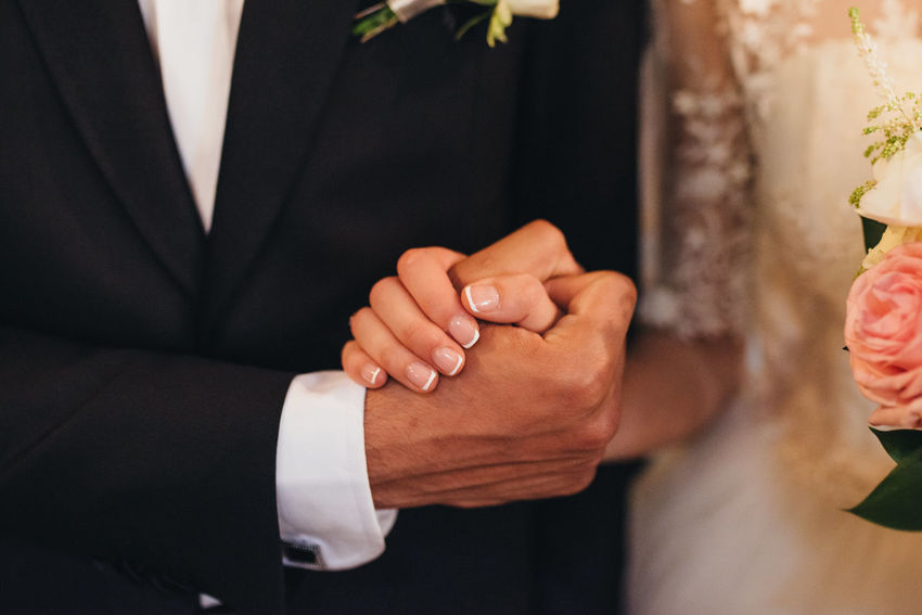 Holding Hands Beginnings Bonding Bride Bridegroom Celebration Celebration Event Ceremony Dedication Groom Human Hand Husband Indoors  Life Events Love Married Men Real People Togetherness Two People Wedding Wedding Ceremony Wedding Dress Wife Women Press For Progress