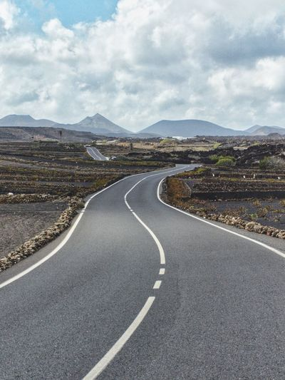 Canary Islands Lanzarote Landscape Road Lonesome Road Volcano Highway Mountain Winding Road Road Mountain Road Road Trip Volcanic Landscape Desert Curve Asphalt Landscape Two Lane Highway Dramatic Landscape Volcanic Activity Road Marking Empty Road