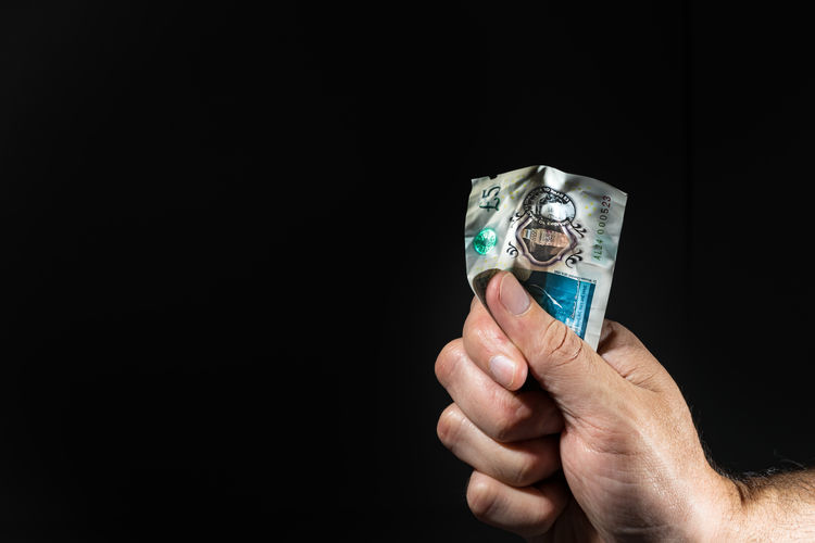 Human Hand Hand Human Body Part Black Background Holding One Person Copy Space Currency Studio Shot Finance Paper Currency Indoors  Business Wealth Close-up Body Part Cut Out Unrecognizable Person Men Finger Economy Human Limb