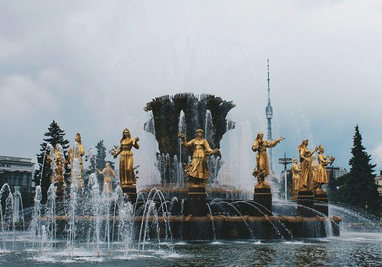 Gold Statues At Druzhba Narodov Against Sky