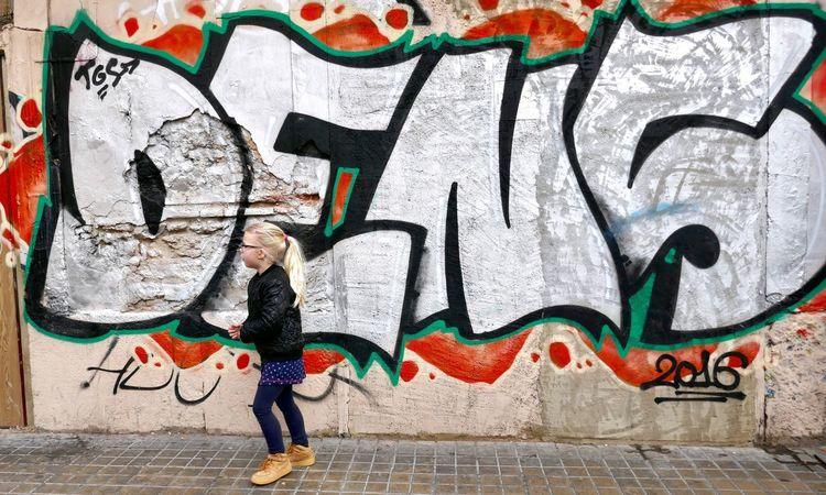Graffiti Creativity Wall - Building Feature Art And Craft Full Length Street Art One Person Artist People Spray Paint Outdoors Blond Girl Blond Long Hairs Day Street Photography The Street Photographer - 2017 EyeEm Awards