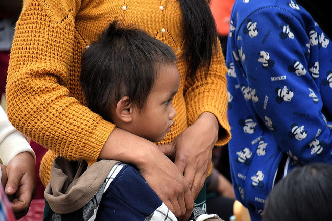 Child protected by his mother watching Adult Child Childhood Close-up Day Human Body Part Outdoors People Two People Vietnam Vietnam Highlands