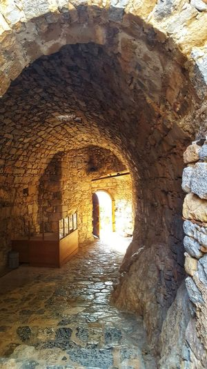 EyeEm Best Shots EyeEmNewHere Eye4photography  Light And Shadow Light In The End Of The Tunnel 🙋 Light Stone Material Stone Leros Leros Island Leros Greece Greece GREECE ♥♥ Greece Photos Arch Ancient Civilization Architecture Built Structure Arched Entryway Open Door Wall Archway Tiled Wall Worn Out Historic Architecture And Art Archaeology Old Ruin Ancient