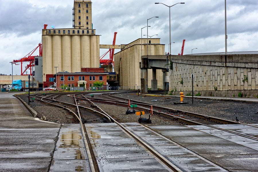 Grain Elevator Industrial Industry Port Of Seattle Railroad Track Raining Rainy Days Shipping Containers Sky And Clouds Architecture Building Exterior Built Structure Cloud - Sky Clouds Clouds And Sky Day Grain Elevators Light Poles No People Outdoors Rail Transportation Railroad Railroad Track Shipping  Shipping Dock Cra Shipping Docks Shipping Terminal Shippingport Sky Street Street Photography Streetphotography Transportation Wet
