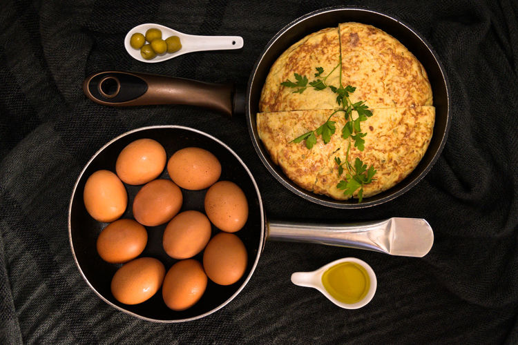 High angle view of eggs in bowl against black background