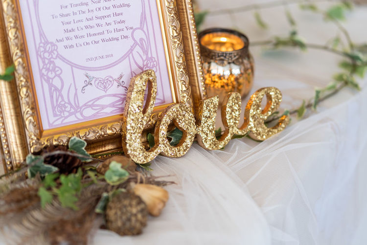 Art And Craft Belief Celebration Close-up Creativity Event Gold Gold Colored High Angle View Indoors  Jewelry No People Ornate Personal Accessory Religion Ring Selective Focus Still Life Table Wedding Wedding Ceremony