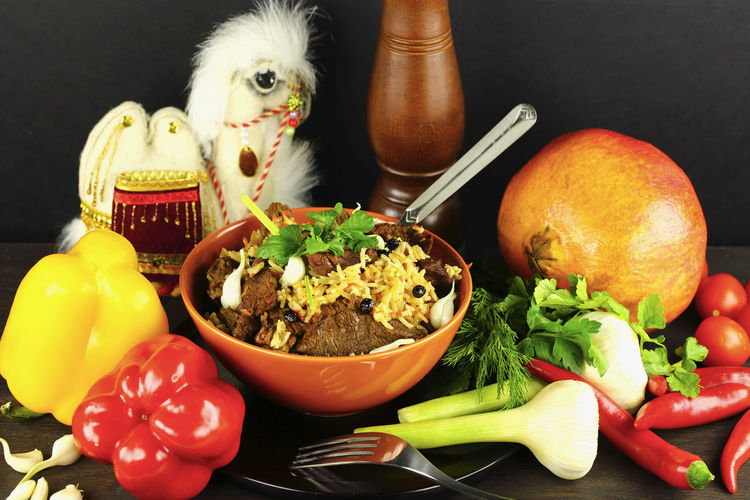 Pilaf, ingredients and souvenir camel, oriental theme, dark background, fresh bright vegetables, Asian homemade cuisine. Traditional cooking Asian  Asian Culture Beef Cooking Cuisine Dark Eating Food And Drink Homemade PILAU Rice Asian Food Food Food And Drink Food Photography Food Stories Foodphotography Healthy Eating Ingradients Meat Oriental Pilaf Recipe Restaurant Vegetable