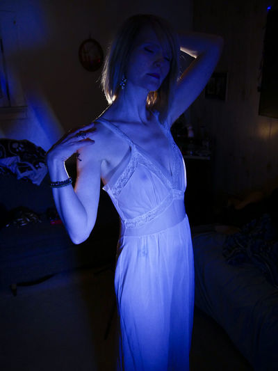 Backlight Adult Blue Dancing Domestic Room Happiness Indoors  Leisure Activity Lifestyles Night Nightgown One Person Real People Sleep Walk Sleeping Cat Sleepy Three Quarter Length Torso Women Young Women