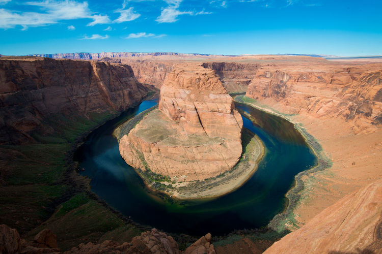Scenic view of horseshoe bend against sky