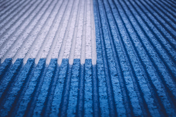 Full frame shot of white and blue parallel striped surface