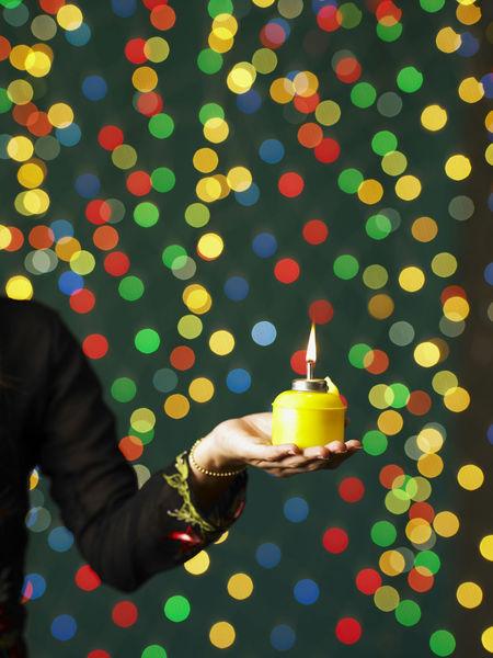 Young lady in baju kurung holding oil lamp Burning Celebration Flame Greeting Happiness Hari Raya Aidilfitri Ramadan Mubarak Selamat Hari Raya Tradition Traditional Clothing Baju Kurung Celebration Cheerful Colored Background Cultural Festival Illuminated Islamic Event Oil Lamp Pelita Real People Seletive Focus Smiling Special Occasion Syawal