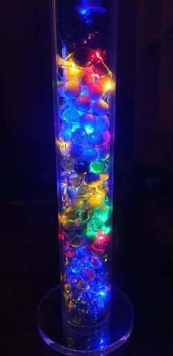 Close-up of illuminated glass lights on table