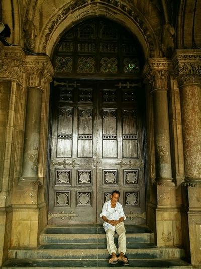 Chhatrapati Shivaji Terminus (CST) Railway Station, Mumbai. Door One Person Travel Destinations Spirituality Place Of Worship Architecture People Bombay Photography Street Sky Cultures Arch Monument Lifestyles Built Structure City Travel History Ancient