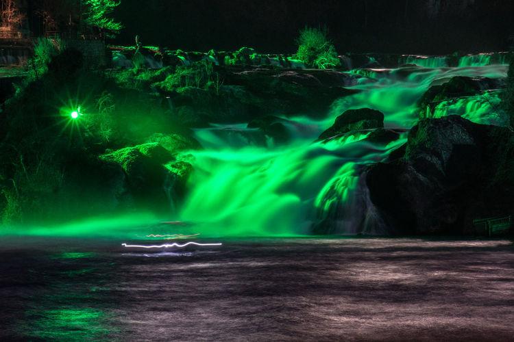 Illuminated fountain at night