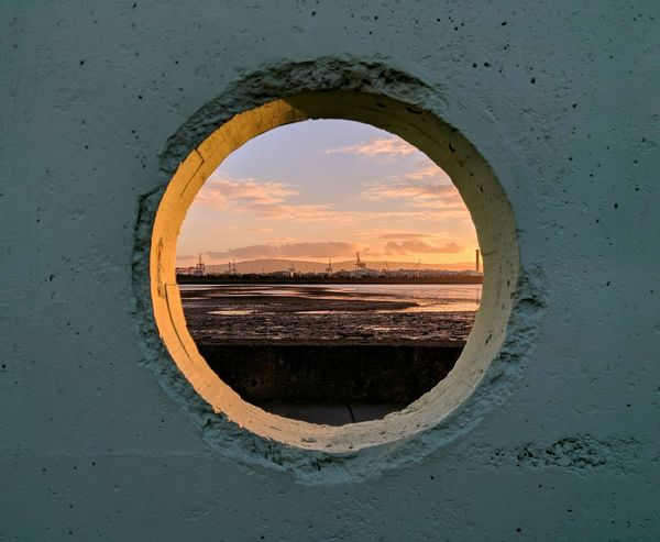 Circle Geometric Shape Orange Color Sunset Window No People Indoors  Nature Sky Water Beauty In Nature Day