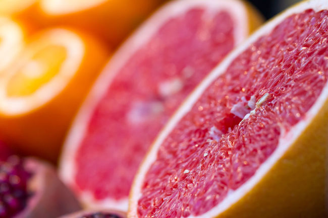 Closeup of sliced grapefruit in a grocery Close-up Color Colorful Food Fresh Freshness Freshness Fruit Fruitporn Fruits Grapefruit Grocery Grocery Store Healthy Eating Macro Macro Photography No People Orange Pomegranate