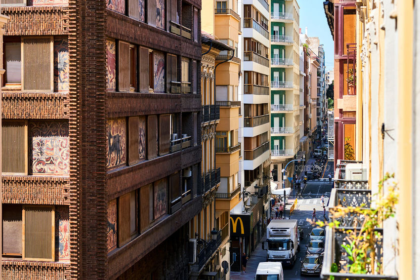Alicante, Spain - May 16; 2017: Narrow streets of Alicante city center. View from the above. Alicante is a main resort city on the Costa Blanca. Spain Alicante, Spain Architecture Balcony Building Exterior Built Structure City City Center Costa Blanca Day Downtown District Editorial  Europe Houses Old Town Outdoors People Residential Building SPAIN Street Summer Summertime Sunny Day Tourist Resort Travel Destinations Urban Landscape