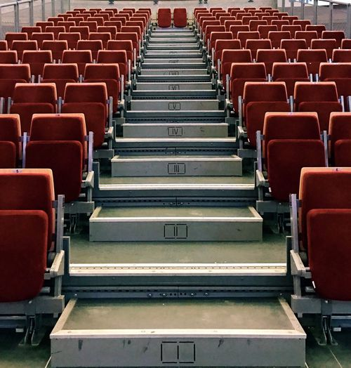 Empty chairs arranging at auditorium