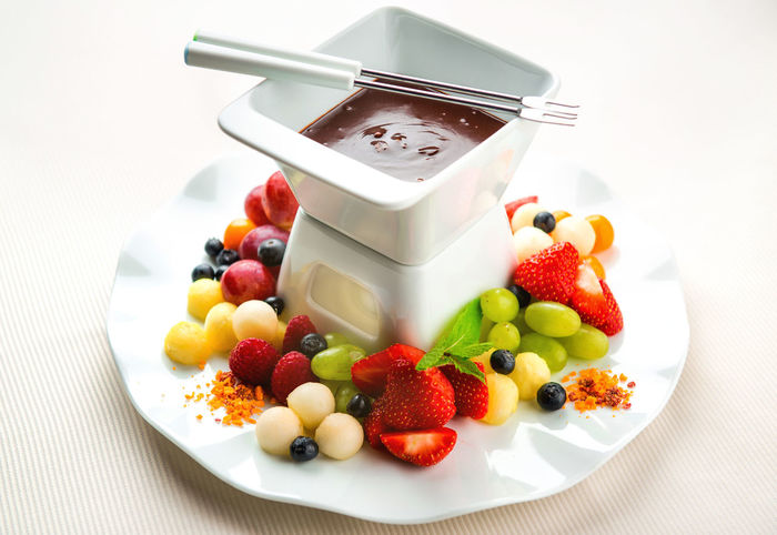 Chocolate fondue with fresh fruits and berries Berries Chocolate Dessert Berry Fruit Bilberry Calories Closeup Delicious Fondue Fresh Fruit Fruits Grape Milk Chocolate Mint Leaf - Culinary Raspberry Ready-to-eat Restaurant Restaurant Food Ripe Fruit Sauce Strawberry Sweet Sweet Food Variation