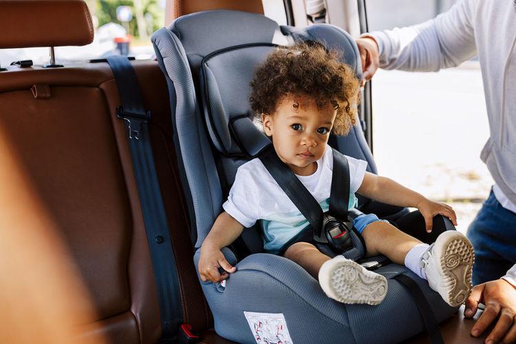 Portrait of baby boy sitting in car