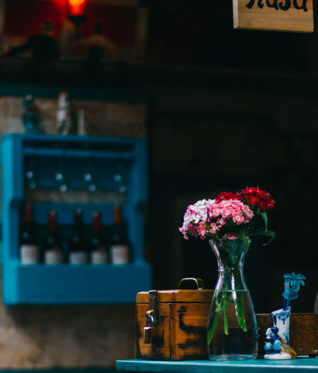 Flowers in vase on table at restaurant
