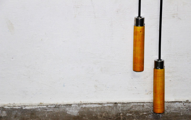 Jump Ropes Hanging Against Wall