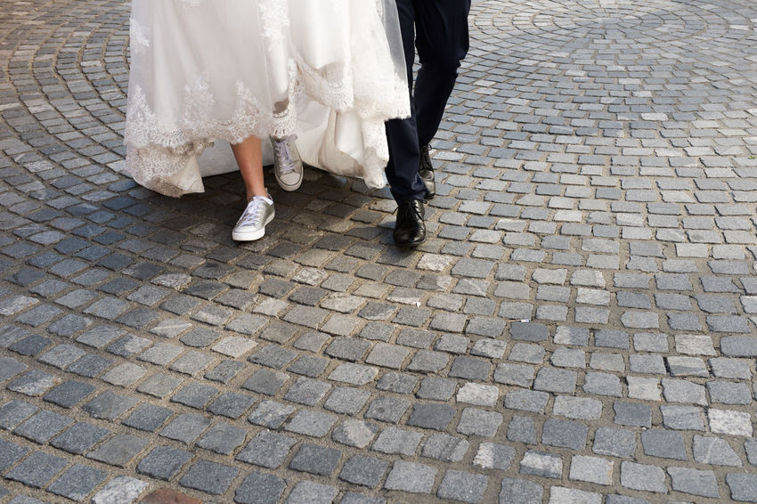 Adult Bride Bridegroom Cobblestone Day Groom Leg Legs Life Events Low Section Men Outdoors People Real People The Photojournalist - 2017 EyeEm Awards The Portraitist - 2017 EyeEm Awards The Street Photographer - 2017 EyeEm Awards Togetherness Two People We Wedding Wedding Wedding Dress Wedding Photography Women Sommergefühle Focus On The Story