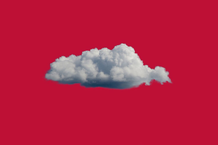 White clouds over red background