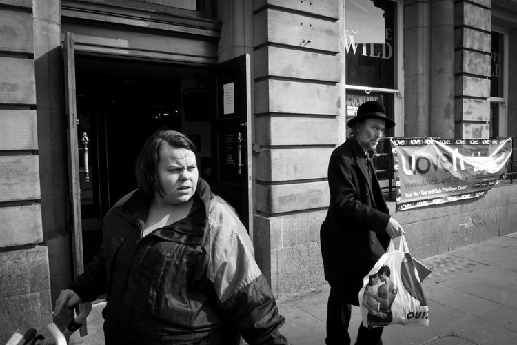 Portrait of happy friends standing in city