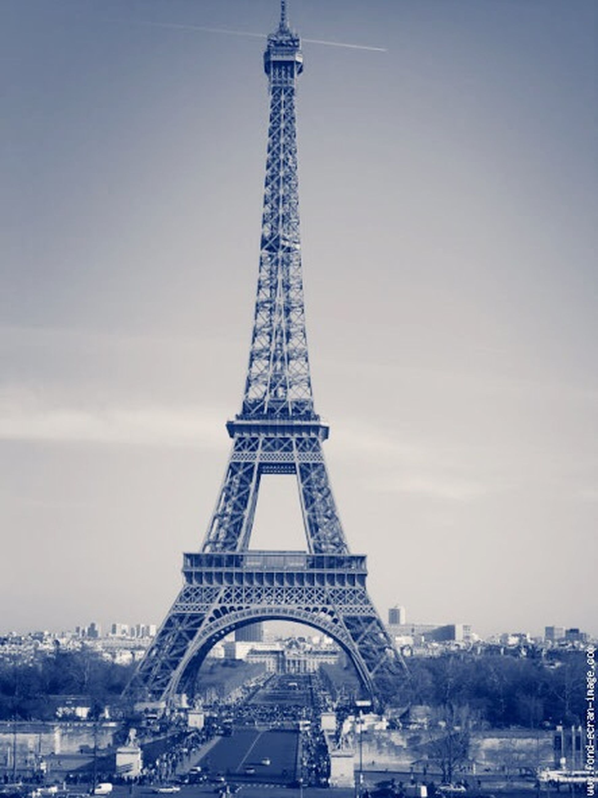 architecture, built structure, eiffel tower, tower, tall - high, international landmark, famous place, capital cities, travel destinations, city, building exterior, tourism, travel, sky, culture, metal, transportation, tall, low angle view, skyscraper