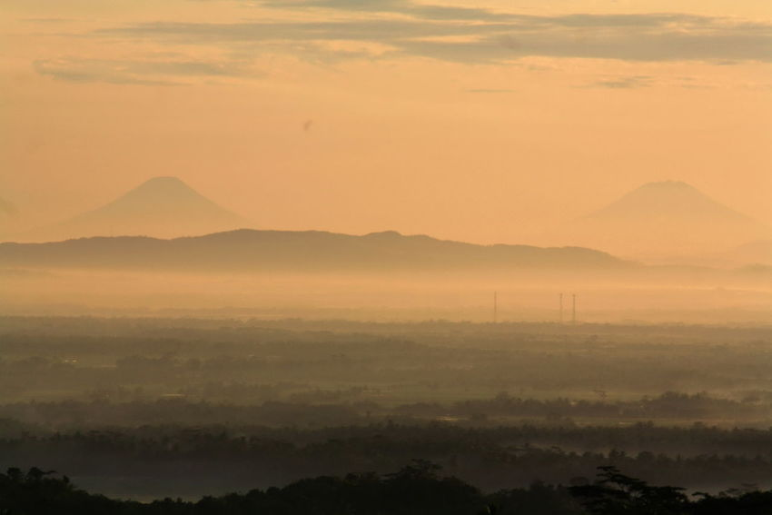 Twin Volcano Beauty In Nature Day Fog Hazy  Idyllic Landscape Mist Mountain Mountain Range Nature No People Outdoors Scenics Silhouette Sky Sunset Tranquil Scene Tranquility Tree