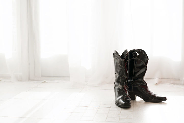 Low section of cowboy boots  shoes at home