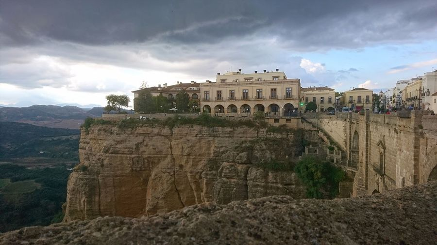 On the ledge. Ronda SPAIN España Ledge Abyss Gorge Mystery Urban Cityscape Urban Beauty Clouds Clouds And Sky Gray Rain Clouds Beauty Green Urban Nature Down Ancient Civilization Ancient History Architecture Sky Built Structure Building Exterior