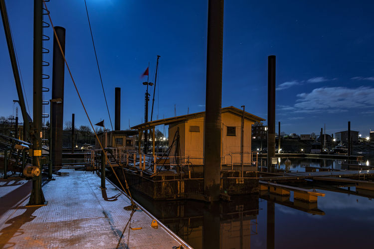 Architecture Blue Building Exterior Built Structure Business Finance And Industry Elbe River Finkenwerder Hamburg Harbour Illuminated Night Night Photography No People Outdoors Sky Sport Boat Harbour Urban Skyline Water