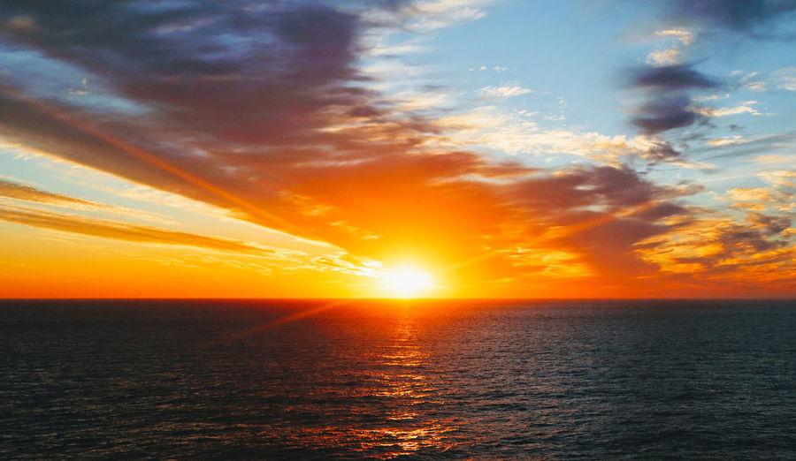 persian gulf Sunrise Water Sea Sunset Sunlight Sun Horizon Dramatic Sky Reflection Idyllic Orange Color Seascape Coast Ocean Rushing Horizon Over Water Romantic Sky Coastal Feature Atmospheric Mood Moody Sky Refraction Sky Only Shining Cloudscape Rippled Low Tide Calm Surf Marram Grass Tide Wave