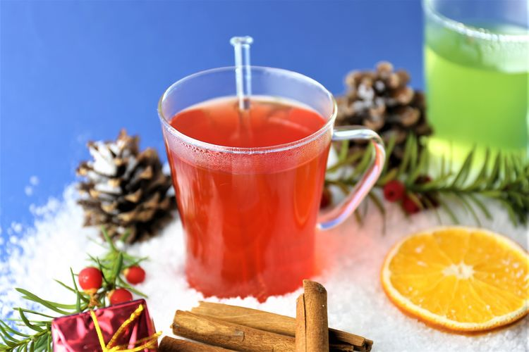 High angle view of colorful drink with snow and ingredients on table